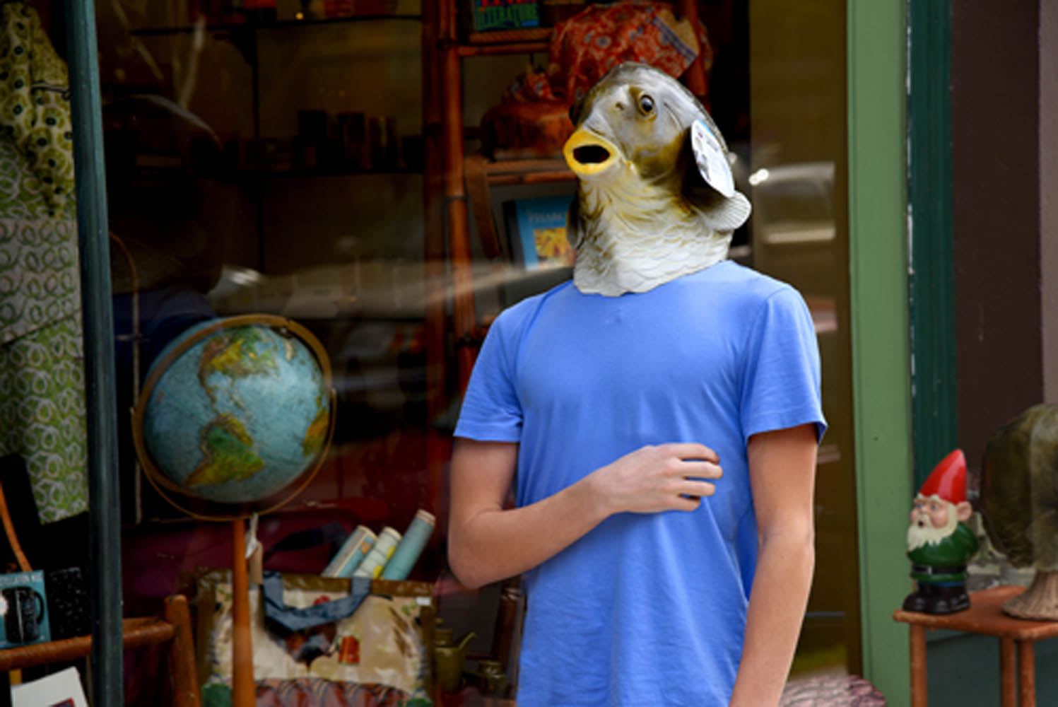A boy dons a fish mask, 2018 © Robert George Photographs
